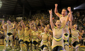 VICTORS! The College of Business Administration BizAd jumps in triumph after being proclaimed as the champion of the 2014 Cheerdance Competition last Aug. 26 at the Lamberto Macias Sports Complex. PHOTO BY Nel Dableo