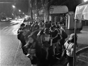 RESOLVED. Students and some members of Silliman University Faculty Association (SUFA) huddled under the drizzling night after the announcement that the strike was over as the faculty union and the administration reached a settlement. Photo From SUFA Facebook page