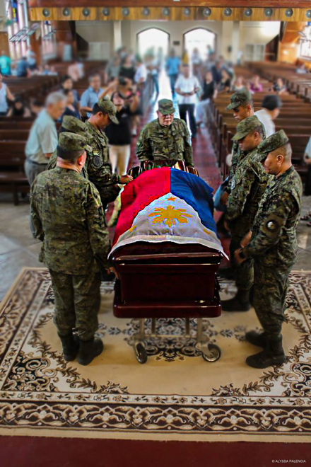 HOLIDAY MOURNING. Pallbearers, headed by Judge Rafael Cresencio C. Tan Jr (center), prepare to carry the remains of the late Justice Venancio Aldecoa Jr to his final resting place after the funeral service last Dec. 17 at Silliman University (SU) Church. Aldecoa served as SU President, 1983-86. PHOTO BY ALYSSA PALENCIA