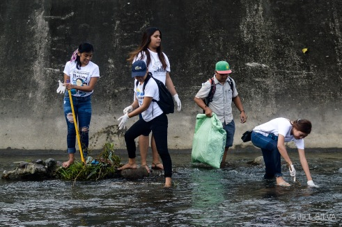 ONE FOR BANICA: Student-volunteers help in a clean-up drive last Jan. 7 at Banica River from Colon Extension overflow to Purok Santan, Brgy. Taclobo, Dumaguete City. PHOTO BY JILL C. SILVA